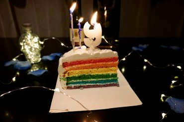 The rainbow cake from Dean & Deluca with the lighted candles on top